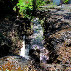 Artificial river created by a ruptured pipe in Brisas flowing for weeks
